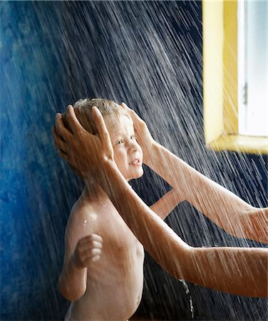 Mother washing son's hair in shower Stock Photo - Premium Royalty-Free, Code: 6122-07703286