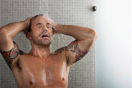 Man washing his hair in shower Stock Photo - Premium Royalty-Free, Code: 6122-07703390