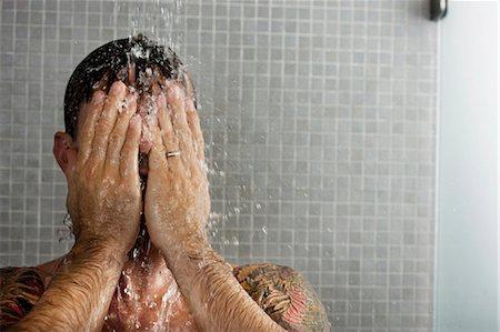 Man washing his hair in shower Stock Photo - Premium Royalty-Free, Code: 6122-07703391