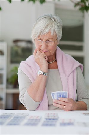 Older woman playing cards Stock Photo - Premium Royalty-Free, Code: 6122-07703560