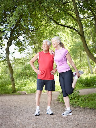 Older couple stretching in park Stock Photo - Premium Royalty-Free, Code: 6122-07703815