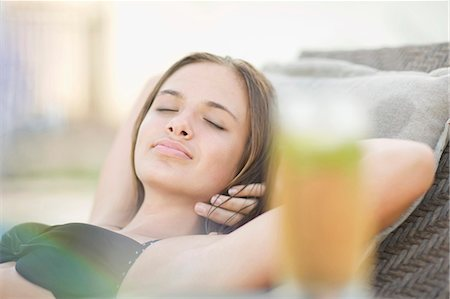 Teenage girl sleeping in lawn chair Stock Photo - Premium Royalty-Free, Code: 6122-07703994