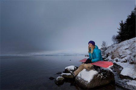 sports and snowboarding - Snowboarder holding board by lake Stock Photo - Premium Royalty-Free, Code: 6122-07704217