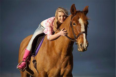 Teenage girl riding horse outdoors Stock Photo - Premium Royalty-Free, Code: 6122-07704337