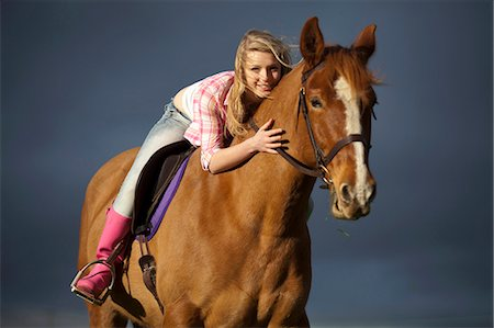 Teenage girl riding horse outdoors Stock Photo - Premium Royalty-Free, Code: 6122-07704337