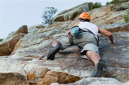 rock climber - Climber scaling steep rock face Stock Photo - Premium Royalty-Free, Code: 6122-07705007