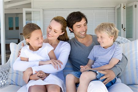 Family relaxing on sofa together Stock Photo - Premium Royalty-Free, Code: 6122-07705575