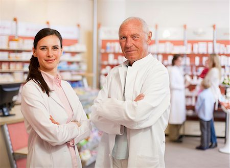 Smiling pharmacists standing in store Stock Photo - Premium Royalty-Free, Code: 6122-07705874