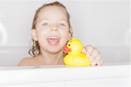 Girl playing with rubber duck in bath Stock Photo - Premium Royalty-Free, Code: 6122-07705818