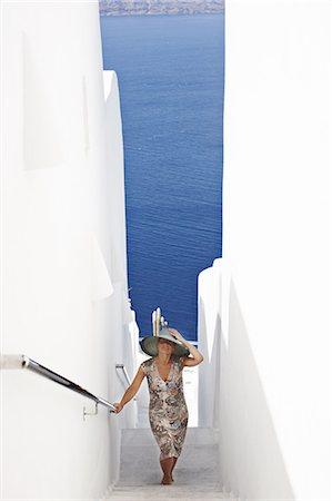 santorini - Woman walking up narrow staircase Stock Photo - Premium Royalty-Free, Code: 6122-07705960