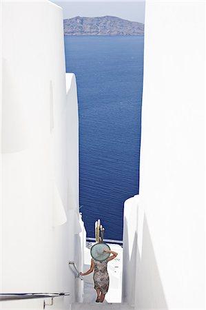 santorini - Woman admiring ocean view Stock Photo - Premium Royalty-Free, Code: 6122-07705961