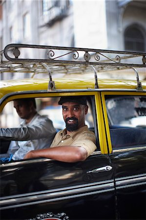 east indian (male) - Smiling man riding in taxi cab Stock Photo - Premium Royalty-Free, Code: 6122-07705984
