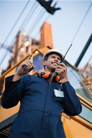 refinery - Worker using walkie talkie on site Stock Photo - Premium Royalty-Free, Code: 6122-07706263