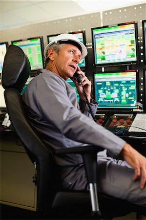 Man working in security control room Stock Photo - Premium Royalty-Free, Code: 6122-07706288