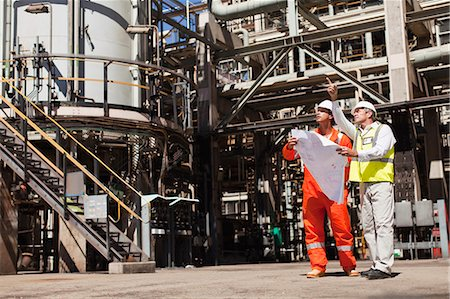 refinery - Workers talking at oil refinery Stock Photo - Premium Royalty-Free, Code: 6122-07706231