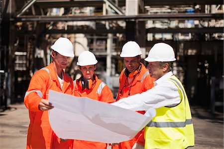 refinery - Workers with blueprints at oil refinery Stock Photo - Premium Royalty-Free, Code: 6122-07706232
