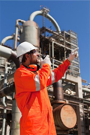 refinery - Worker with walkie talkie on site Stock Photo - Premium Royalty-Free, Code: 6122-07706236