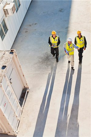shadow - Workers casting shadows on site Stock Photo - Premium Royalty-Free, Code: 6122-07706397