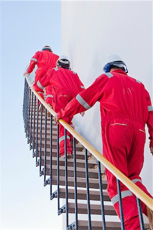 Workers on steps at chemical plant Stock Photo - Premium Royalty-Free, Code: 6122-07706305