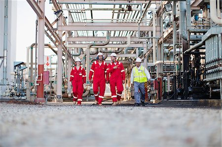 refinery - Workers walking at chemical plant Stock Photo - Premium Royalty-Free, Code: 6122-07706310