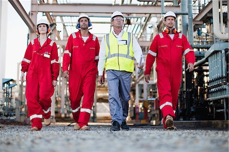 refinery - Workers walking at chemical plant Stock Photo - Premium Royalty-Free, Code: 6122-07706311