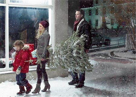 snow christmas tree white - Family carrying Christmas tree in snow Stock Photo - Premium Royalty-Free, Code: 6122-07706504