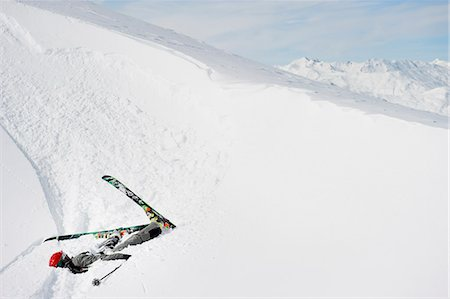 Skier doing flip on snowy slope Stock Photo - Premium Royalty-Free, Code: 6122-07706662