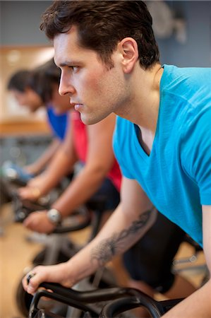 fitness   mature woman - People using spin machines in gym Stock Photo - Premium Royalty-Free, Code: 6122-07706612