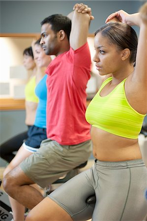 People stretching on spin machines Stock Photo - Premium Royalty-Free, Code: 6122-07706622