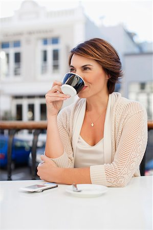 day - Woman drinking coffee in cafe Stock Photo - Premium Royalty-Free, Code: 6122-07706762