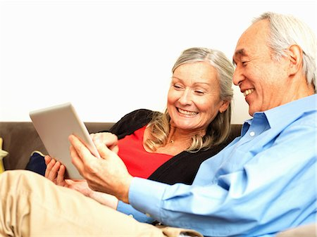 Older couple using tablet computer Stock Photo - Premium Royalty-Free, Code: 6122-07707327