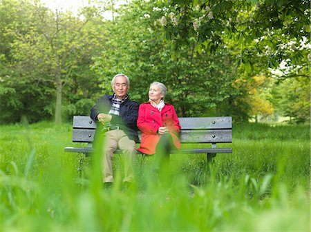Older couple sitting on park bench Stock Photo - Premium Royalty-Free, Code: 6122-07707324