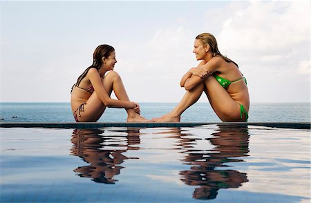 Mother and daughter at edge of pool Stock Photo - Premium Royalty-Free, Code: 6122-07707459
