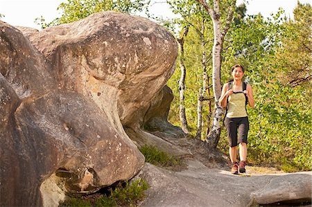 Hiker walking on rock formations Stock Photo - Premium Royalty-Free, Code: 6122-07707584