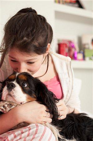 dog kissing girl - teenage girls playing with dog at home Stock Photo - Premium Royalty-Free, Code: 6122-08211939