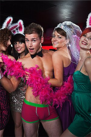 Young women on hen night with male stripper Stock Photo - Premium Royalty-Free, Code: 6122-08212398