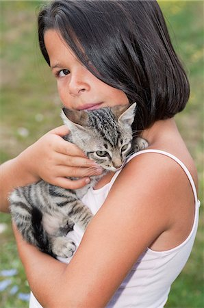 preteen girl pussy - Girl holding pet cat, portrait Stock Photo - Premium Royalty-Free, Code: 6122-08212425