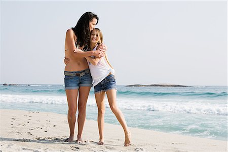 preteen kissing - Mother and daughter hugging on a beach Stock Photo - Premium Royalty-Free, Code: 6122-08212664