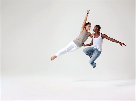 Two young men in mid air Stock Photo - Premium Royalty-Free, Code: 6122-08212737