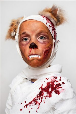 dripping blood - Child in bloody Halloween costume Stock Photo - Premium Royalty-Free, Code: 6122-08229047