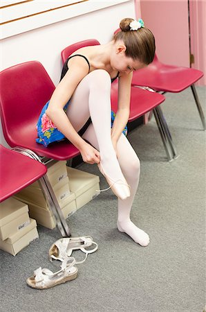 preteen beauty - Ballet student tying slippers Stock Photo - Premium Royalty-Free, Code: 6122-08229369