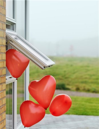 fly heart - Heart-shaped balloons outside window Stock Photo - Premium Royalty-Free, Code: 6122-08229647