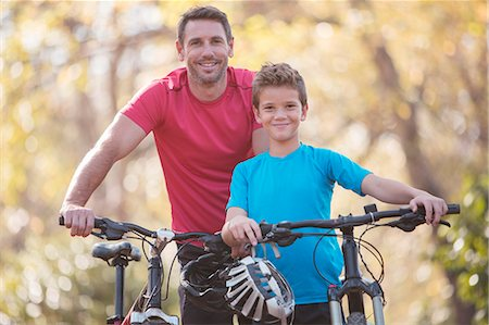 father with two sons not girls - Portrait father and son bike riding Stock Photo - Premium Royalty-Free, Code: 6124-08170357