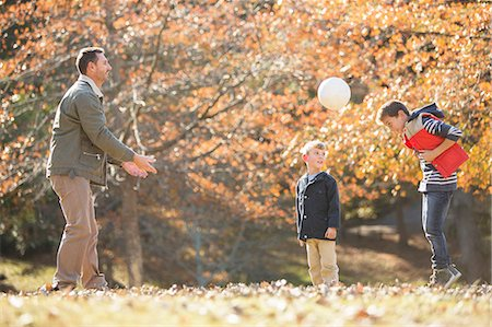 Father and sons playing soccer in autumn park Stock Photo - Premium Royalty-Free, Code: 6124-08170444