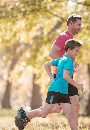 father with two sons not girls - Father and son jogging in park Stock Photo - Premium Royalty-Free, Code: 6124-08170418