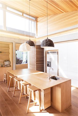photography - Modern pendant lights hanging over wooden kitchen island Stock Photo - Premium Royalty-Free, Code: 6124-08170641