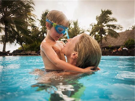 Mother and son hugging in swimming pool Stock Photo - Premium Royalty-Free, Code: 6124-08658147