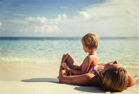 Mother and son laying and relaxing on tropical beach Stock Photo - Premium Royalty-Free, Code: 6124-08658151