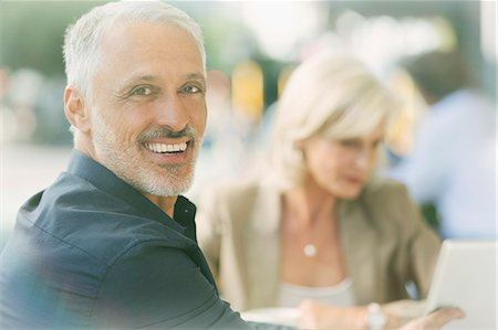 Portrait smiling businessman at sidewalk cafe Stock Photo - Premium Royalty-Free, Code: 6124-08743220