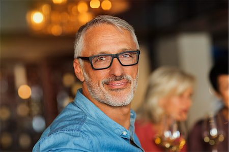 Portrait confident man with eyeglasses at bar Stock Photo - Premium Royalty-Free, Code: 6124-08743226